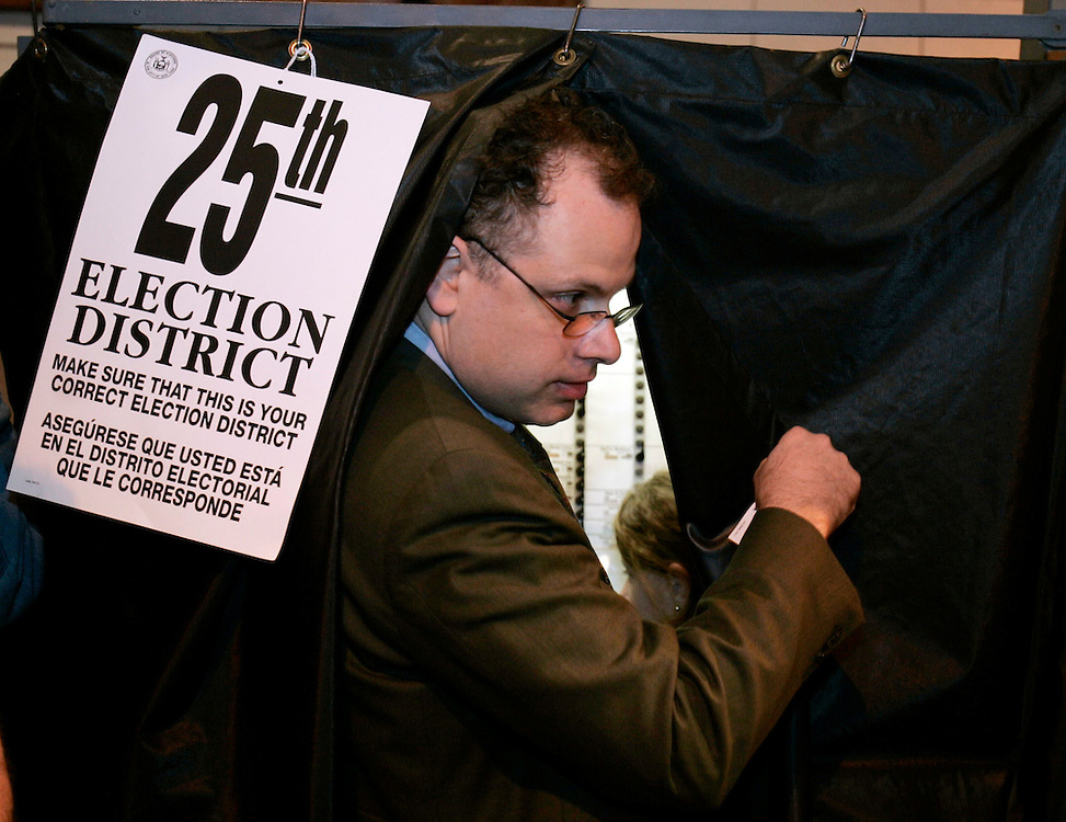Unidentified man casts his vote in the US General Election   at Public School 321 in the Park Slope section of the Brooklyn borough of New York City, Tuesday  02 November 2004. EPA/ANDREW GOMBERT