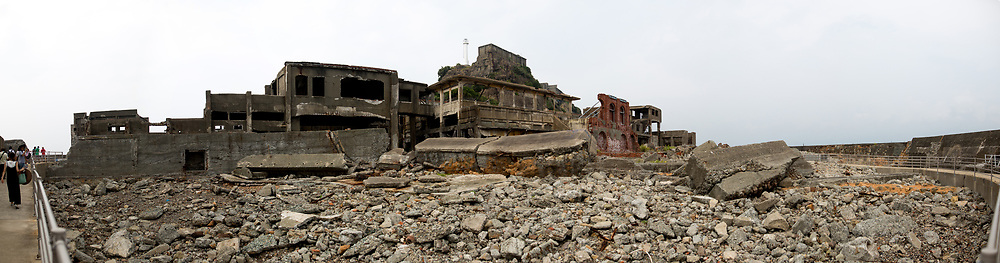 "NAGASAKI, JAPAN - AUGUST 8: Panoramic view inside of Hashima Island, commonly known as Gunkanjima or ""Battleship Island"" in Nagasaki Prefecture, southern Japan on August 8, 2017. The island was a coal mining facility until its closure in 1974 is a symbol of the rapid industrialization of Japan, a reminder of its dark history as a site of forced labor during the Second World War. The island now is recognized as UNESCO's World Heritage sites of Japan's Meiji Industrial Revolution. (Photo: Richard Atrero de Guzman/AFLO)"