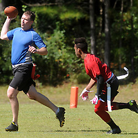 Defense in Depth's John Hannah looks to throw against YGH's Joe Phillips at Castle Hayne Park Sunday October 5, 2014. (Jason A. Frizzelle(
