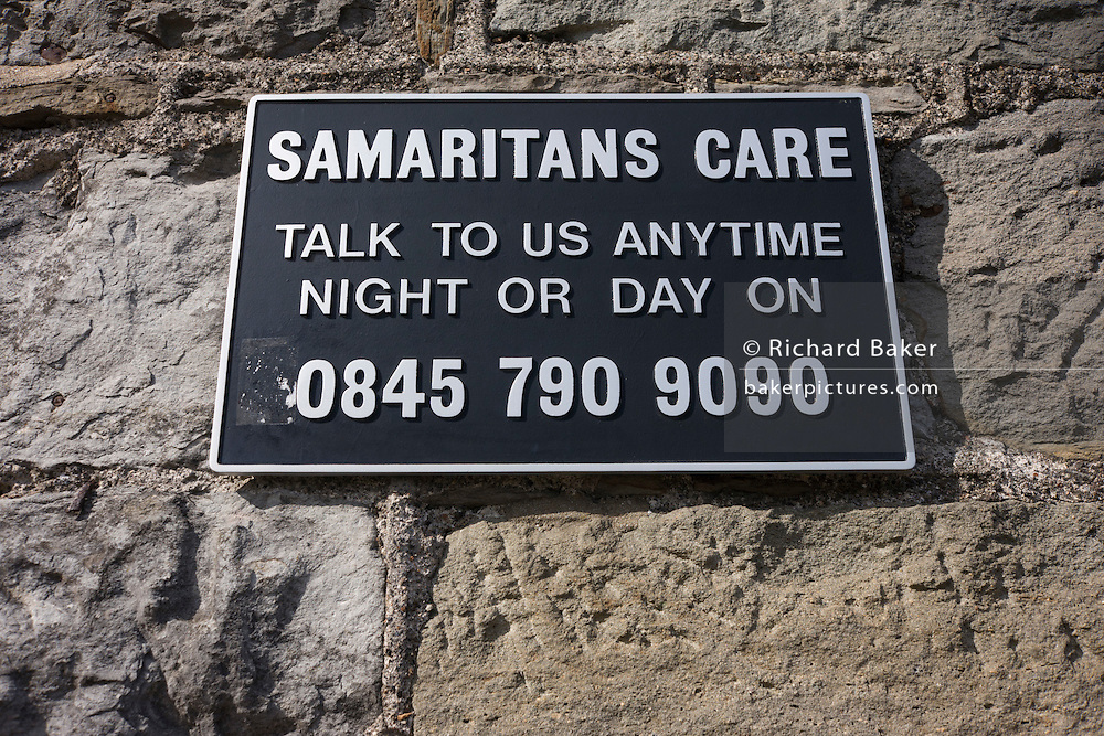 A Samaritans suicide 0845 helpline sign on Brunel's Clifton suspension bridge in Bristol.