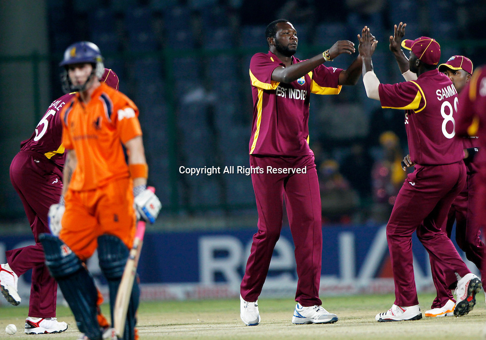 28.02.2011 Cricket World Cup from the Feroz Shah Kotla stadium in Delhi. West indies v Netherlands. Sulieman Benn of West Indies celebrates the wicket of Alexei Kervezee during the match of the ICC Cricket World Cup between Netherlands and West Indies on the 28th February 2011