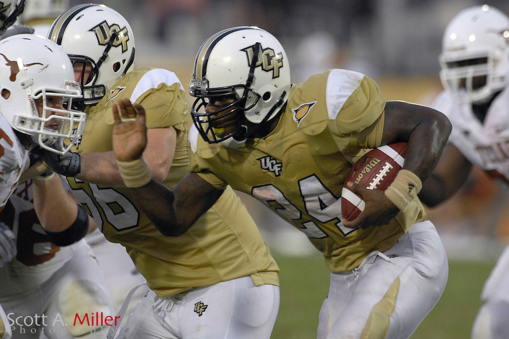 Sep 15, 2007; Orlando, FL, USA; Central Florida Knights running back (24) Kevin Smith heads up field during his team's 35-32 loss to the Texas Longhorns at Bright House Stadium. ...©2007 Scott A. Miller