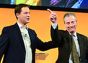 © Licensed to London News Pictures. 08/03/2013. Brighton, UK. Leader of the Liberal democrats and Deputy Prime Minister Nick Clegg congratulates Mike Thornton MP on stage after he won the Eastleigh by-election.  International Women's Day at the Party Rally Liberal Democrat Spring Conference in Brighton today 8th March 2013. Photo credit : Stephen Simpson/LNP