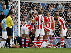 Concern as Stoke City's Robert Huth lies injured - Photo mandatory by-line: Matt Bunn/JMP - Tel: Mobile: 07966 386802 14/09/2013 - SPORT - FOOTBALL -  Britannia Stadium - Stoke-On-Trent - Stoke City V Manchester City - Barclays Premier League