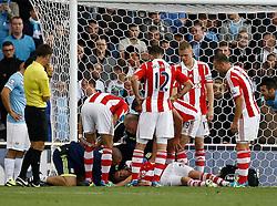 Concern as Stoke City's Robert Huth lies injured - Photo mandatory by-line: Matt Bunn/JMP - Tel: Mobile: 07966 386802 14/09/2013 - SPORT - FOOTBALL -  Britannia Stadium - Stoke-On-Trent - Stoke City V Manchester City - Barclays Premier League