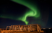 Northern Lights seen from the island of Röst (Lofoten, Norway) in February 2013. Do note the scaffolds for drying cod in the foreground.