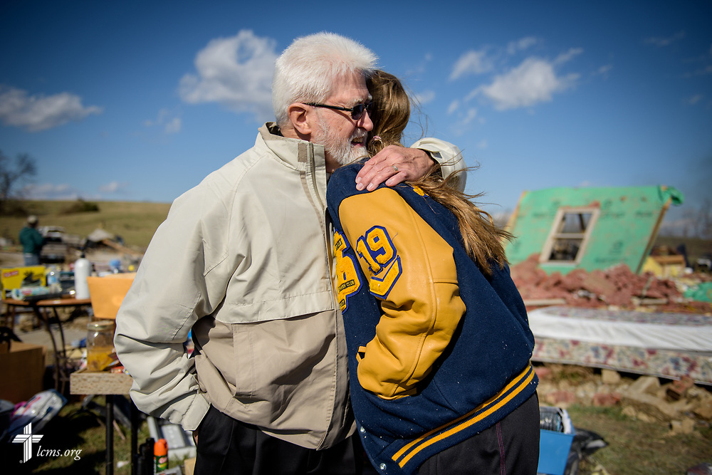 The Rev. Thomas Handrick, Sr., comforts Megan Huber at her family's destroyed home on Wednesday, March 1, 2017, in Perryville, Mo. Violent tornadoes ripped through the area the night before. LCMS Communications/Erik M. Lunsford