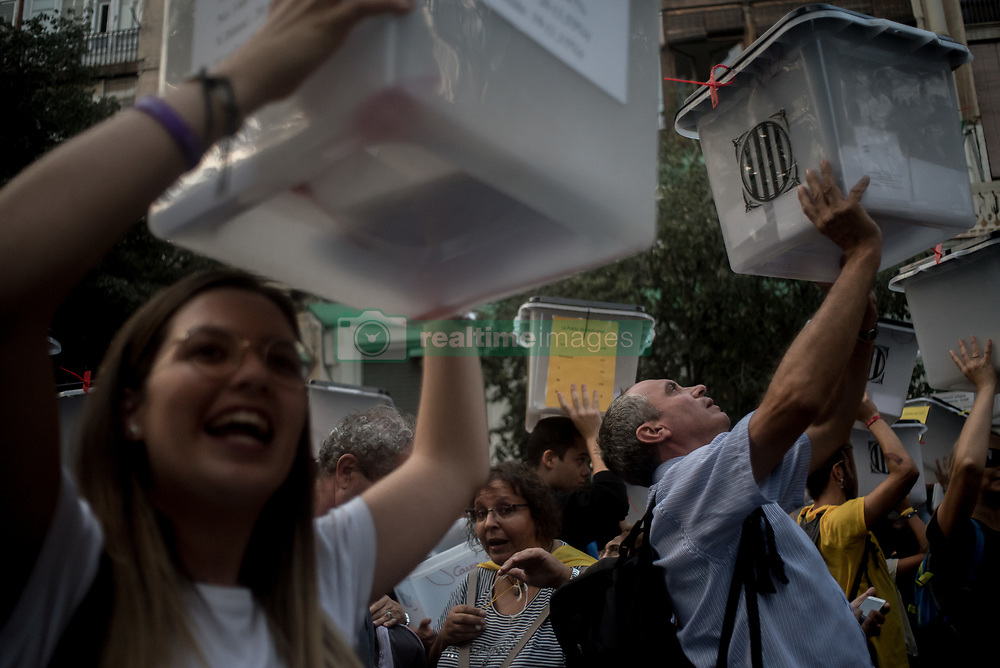 October 1, 2018 - Barcelona, Catalonia, Spain - People holding  ballot boxes used on past independence referendum banned by Spanish kingdom goes by  Barcelona streets on first October 2018. Thousands marched in Barcelona remembering the referendum on independence held a year ago that led hundreds of injured voters due the Spanish police crackdown. (Credit Image: © Jordi Boixareu/ZUMA Wire)