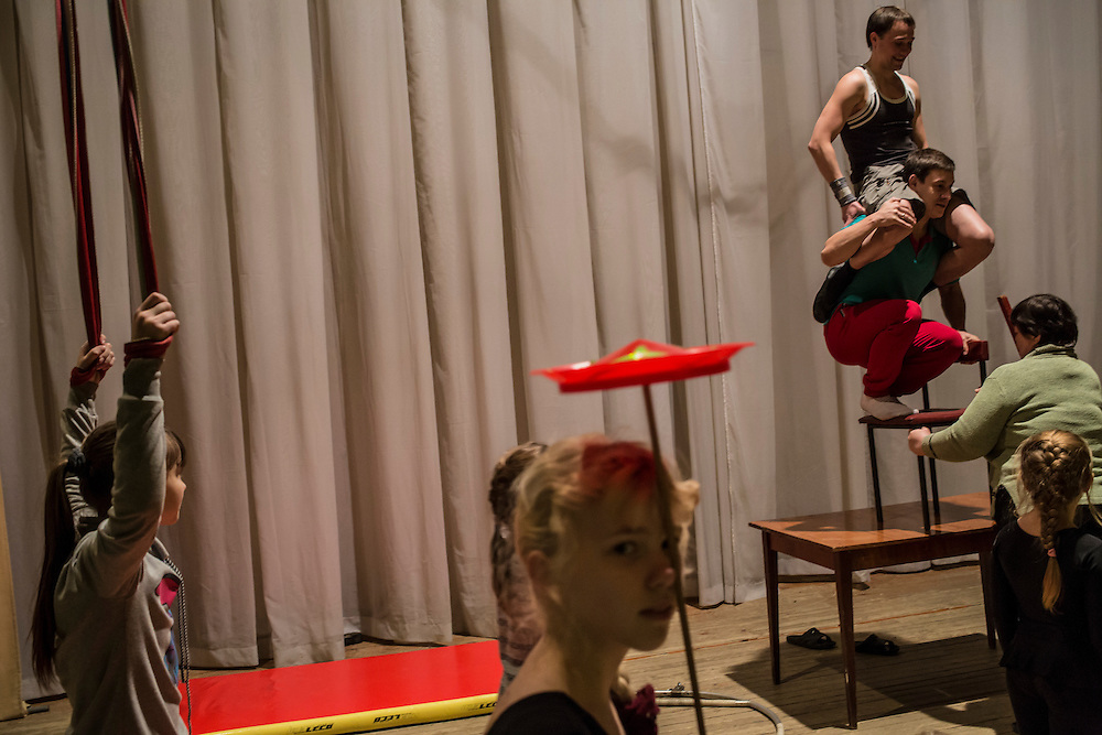 Girls rehearse for an acrobatic show at the local arts center on Tuesday, November 12, 2013 in Asbest, Russia.