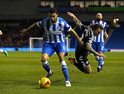 Connor Goldson of Brighton and Hove Albion and Sam Saunders of Brentford challenge for the ball - Mandatory byline: Paul Terry/JMP - 05/02/2016 - FOOTBALL - Falmer Stadium - Brighton, England - Brighton v Brentford - Sky Bet Championship