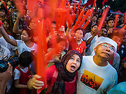08 NOVEMBER 2015 - YANGON, MYANMAR: National League for Democracy supporters cheer as another vote for the NLD was announced during the vote count Sunday. The vote count was shown live on television. The citizens of Myanmar went to the polls Sunday to vote in the most democratic elections since 1990. The National League for Democracy, (NLD) the party of Aung San Suu Kyi is widely expected to get the most votes in the election, but it is not certain if they will get enough votes to secure an outright victory. The polls opened at 6AM. In Yangon, some voters started lining up at 4AM and lines were reported to long in many polling stations in Myanmar's largest city.    PHOTO BY JACK KURTZ