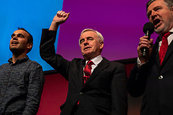 © Licensed to London News Pictures. 26/09/2018. Liverpool, UK. Shadow Chancellor John McDonnell MP holds his fist up as delegates sing the Red Flag after Jeremy Corbyn's closing speech at the Labour Party Conference. Photo credit: Rob Pinney/LNP