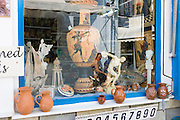Skiathos, Greece 6th August 2012. Greek souvenirs in a shopwindow waiting for tourists in the streets of Skiatos.