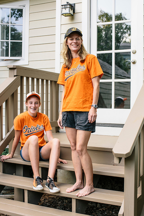 """Meredith Case Ellison, 13, left, and her mom Lauren Case, who live in Washington D.C. have been lifelong Orioles fans. Meredith even made custom orange and black Converse shoes with the slogan """"Go Orioles"""" stitched into the side."""