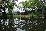 "The aptly named ""Rasender Roland"" (Speeding Roland) is a vintage narrow gage steam railway line linking Lauterbach and Goeren. Here it is reflected in a pond near Posewald Station."