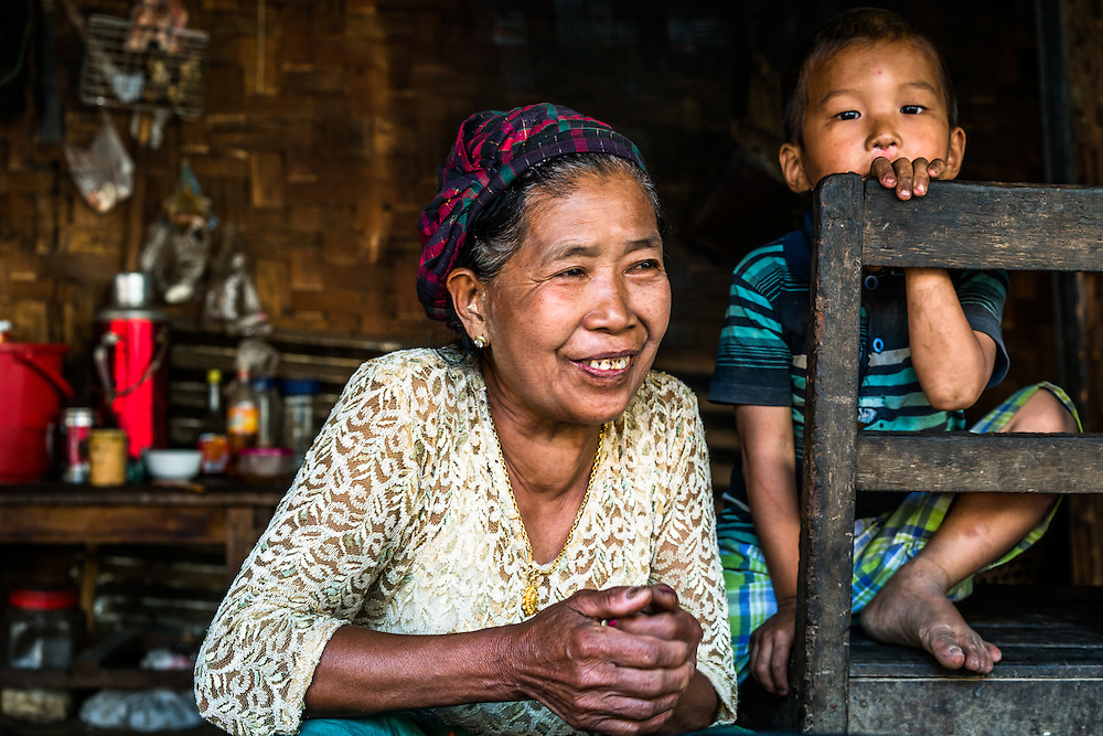 MYITKYINA, MYANMAR - MARCH 13th, 2016: Phaw La Htu, 61, a resident of Shwezet IDP village. She, her family of 14, and nearly 500 others were forced to relocate here in 2011 because of escalated fighting in her former village between the Kachin Independence Army, KIA, and the Burmese government, which has been in various states of conflict since 1994. She says she would love to return home, but will only do so when everyone does, as she's scared to be there alone.