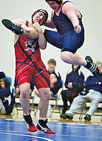 Wallace High's Curtis Dolson lifts Adrian Sherman from Lake City before slamming him to the floor during the 215-pound match Friday at the Coeur d'Alene Invitational. Dolson end the match with a pin in the first period.