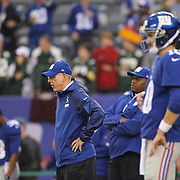 Tom Coughlin, (left), head coach of the New York Giants and quarterback Eli Manning during warm up before the New York Giants Vs Green Bay Packers, NFL American Football match at MetLife Stadium, East Rutherford, New Jersey, USA. 17th November 2013. Photo Tim Clayton
