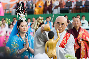 The annual Lotus Lantern Festival is held to celebrate Buddha's Birthday. Opening ceremony for the parade at Dongdaemun Stadium. Buddha statue, symbolically bathed with water by venerable supreme Buddhist monks at the end of the ceremony.