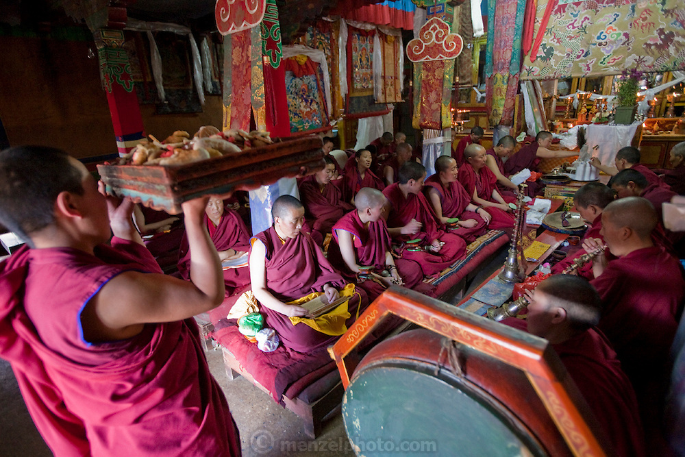 Buddhist nuns during a ceremony at the Lhasaani Tsang Kung Nunnery in Lhasa, Tibet.