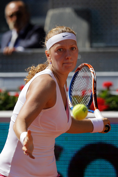 Petra Kvitova from Czech Republic returns the ball during the match against Victoria Azarenka from Belarus in the Madrid Open tennis tournament in Madrid, Sunday, May 8, 2011.