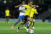 Burton Albion midfielder Marcus Harness (22) heads for goal during the EFL Cup match between Burton Albion and Bury at the Pirelli Stadium, Burton upon Trent, England on 10 August 2016. Photo by Aaron  Lupton.