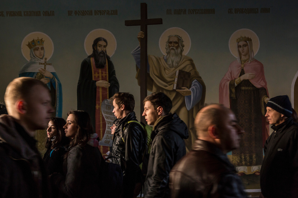 KIEV, UKRAINE - FEBRUARY 21: People pass in and out of the Mikhailovsky Monastery, which has supported anti-government protesters, on February 21, 2014 in Kiev, Ukraine. After a week that saw new levels of violence, with dozens killed, opposition and government representatives reached an agreement intended to resolve the crisis. (Photo by Brendan Hoffman/Getty Images) *** Local Caption ***