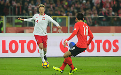 March 27, 2018 - Chorzow, Poland - Lukasz Teodorczyk of Poland vies Young-sun Yun (KOR),  during the international friendly soccer match between Poland and South Korea national football teams, at the Silesian Stadium in Chorzow, Poland on 27 March 2018. (Credit Image: © Foto Olimpik/NurPhoto via ZUMA Press)