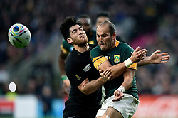 Fourie du Preez of South Africa passes the ball before being tackled by Nehe Milner-Skudder of New Zealand - Mandatory byline: Patrick Khachfe/JMP - 07966 386802 - 24/10/2015 - RUGBY UNION - Twickenham Stadium - London, England - South Africa v New Zealand - Rugby World Cup 2015 Semi Final.