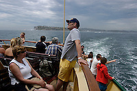 Tourists on the ferry en route to Manly with Watsons bay in the background, Sydney, Australia. January 2nd-11th 2007