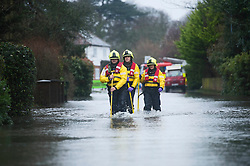 © London News Pictures. 11/02/2014. Wraysbury, UK.  A fire rescue crew in Wraysbury, Berkshire. The area has been hit hard by recent flooding from the nearby Thames River. Photo credit : Ben Cawthra/LNP