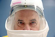 Dr. A Scott Lea is seen in full personal protective equipment (PPE)  and helmet on Thursday, October 30, 2014 at UTMB in Galveston, TX. The PPE uniform has a battery that ventilates the uniform .(Photo: Thomas B. Shea/For the Wall Street Journal)