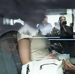 """24.06.2011, Grenzübergang, Thoerl Maglern, ITA, Wiener Betonleichen Morde. Italienische Polizeieinheiten haben am 10.06.2010 die gesuchte Eissalonbesitzerin Goidsargi Estibaliz C. im Ortszentrum von Udine, Italien, verhaftet. Demnach wurde die 32-Jährige Chefin des Eissalon """"Schleckeria""""  von mobilen Einheiten in der Nähe des Bahnhofs gestellt. Gegen Goidsargi Estibaliz C. bestand nach dem Fund von Teilen zweier einbetonierter Leichen in ihrem Kellerabteil in Wien Meidling ein EU-Haftbefehl. Verdächtigt wurde die gebürtige Spanierin, nachdem diese nach der Entdeckung der Leichen anfangs dieser Woche die Flucht ergriffen hatte. Eine der Leichen ist ihr vermisster Ex-Freund Manfred H. Vom zweiten Toten wurde bisher nur der Kopf gefunden, es dürfte sich dabei um ihren deutschen Ex-Ehemann Manfred H. handeln. Nachdem am Fr. 17.06.2011 das zuständige Untersuchungsgericht die Auslieferung der Frau nach Österreich beschlossen hat, wird Goidsargi Estibaliz C. heute durch italienische Beamte von der Justizanstalt Triest zum Grenzübergang Thörl Maglern überstellt und dort an die österreichischen Behörden übergeben. Hier im Bild Goidsargi Estibaliz C.wird von österreichischen Beamten Beamten von der Grenzpolizeistation Thörl Maglern in die Justizanstalt Klagenfurt überstellt.. Für die unter Mordverdacht stehende Goidsargi Estibaliz C., gilt die Unschuldsvermutung! EXPA Pictures © 2011, PhotoCredit: EXPA/ J. Groder"""