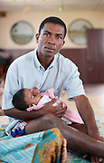 Father holds his child whilst waiting for news on the World Care surgery program provided by Operation Smile.<br />