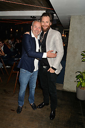 Left to right, PIERS ADAM and MARC BURTON at the launch of Geisha at Ramusake hosted by Piers Adam and Marc Burton at Ramusake, 92B Old Brompton Road, London on 11th June 2015.