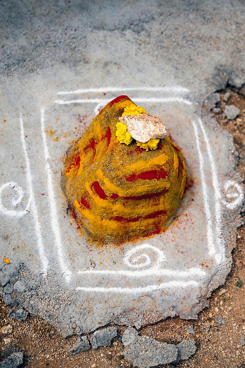 PUTTARPATHI, INDIA - 27th October 2019 - Pookalam pattern and religious shrine on floor of temple in village surrounding Puttarpathi, Andhra Pradesh, South India
