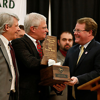 Thomas Wells | Buy at PHOTOS.DJOURNAL.COM<br /> George Hubbard, left, and his brother, Ben, accept this Spring 2017 National Buyer Appreciation Award from Tupelo Mayor Jason Shelton on Thursday.