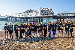 © Licensed to London News Pictures. 23/02/2019. Brighton, UK. Members of the public relax on the beach in Brighton and Hove as sunny weather is hitting the seaside resort. Photo credit: Hugo Michiels/LNP