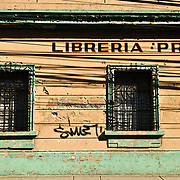 Side of the building of the Libreria Proa, an historic old bookshop in downtown Guatemala City, Guatemala.