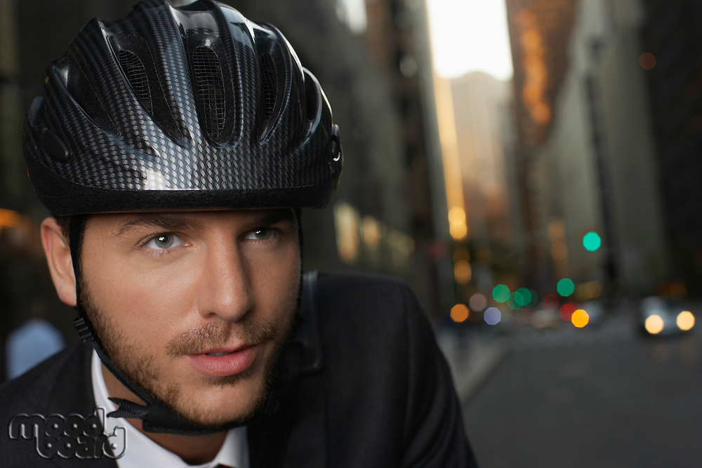 Man wearing cycling helmet on street close-up portrait
