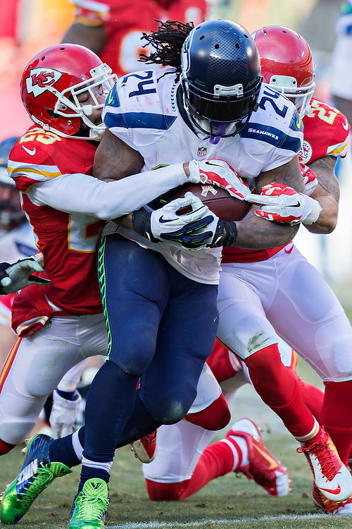 KANSAS CITY, MO - NOVEMBER 16:  Marshawn Lynch #24 of the Seattle Seahawks is tackled in the third quarter by Phillip Gaines #23 of the Kansas City Chiefs at Arrowhead Stadium on November 16, 2014 in Kansas City, Missouri.  The Chiefs defeated the Seahawks 24-20.  (Photo by Wesley Hitt/Getty Images) *** Local Caption *** Marshawn Lynch; Phillip Gaines