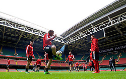 CARDIFF, WALES - Saturday, March 26, 2016: Wales' James Chester, Joe Allen, Sam Vokes and Chris Gunter during a training session at the Millennium Stadium ahead of the International Friendly match against Ukraine. (Pic by David Rawcliffe/Propaganda)