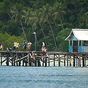 People fishing on a jetty.