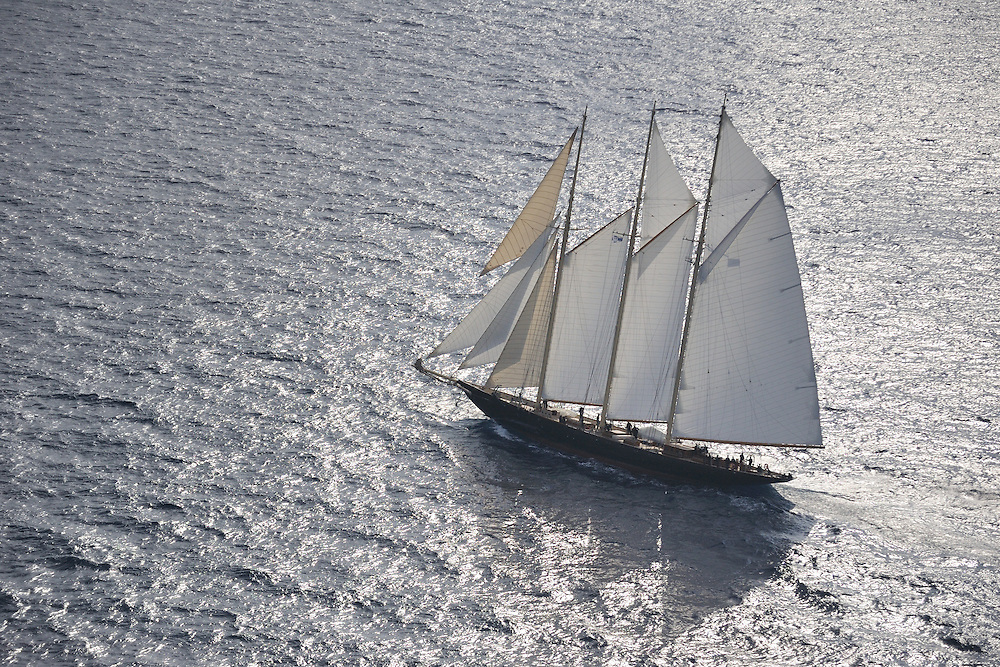 The 2010 Sailing yacht Atlantic is magnificent replica of the 1903 William Gardner designed three-masted sailing schooner Atlantic, owned by Ed Kastelein. The 1903 sailing schooner was a long time World record holder for the crossing of the Atlantic Ocean under sail in 1905 winning the Kaiser's Cup from New York to The Lizard. The record held firm for almost a century, when it was broken in 1998. It is the longest standing speed record in the Yachting History. .The Owner, Ed Kastelein is the man responsible for the recreation of this wonderful new schooner Atlantic, and is also behind such projects as the sailing yacht Thendara, sailing yacht Aile Blanche, sailing yacht Borkumriff, sailing yacht Zaca a te Moana and most recently the Herreshoff racing schooner Eleonora E...The Dutch Van der Graaf yard first launched the Sailing Yacht Atlantic in 2008. Following her launch, she underwent an extensive programme of fitting out. 2009 saw the assembly of her three masts, with a height of 45 metres, supporting 1700m² of sails. Her raven black high gloss hull reflects the ripples of the water and one glance at the three towering masts, instantly give the sense of power that this mighty yacht Atlantic has...Sailing schooner Atlantic is the largest classic sailing schooner ever created, measuring 185 feet (56 metres) over deck and with the bowsprit to boom length of 227 feet (69 metres). Her graceful sheerline and long overhangs accentuate her grace while her waterline length of 42 meters and narrow beam are a promise for unmatched speed under sail...On June 23rd 2010, sailing schooner Atlantic sailed out to sea, three years after her keel was laid. The Owner, Ed Kastelein, saw his long term dream come true, as he witnesses his family, guest and crew step on board of Atlantic yacht. Her maiden voyage was a two month leisurely cruise from Rotterdam to Cannes and she exceeded all expectations, sailing fast at every point of sail with amazing ease and comfort.Yacht Charter Accom