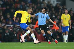 Brazil's Miranda (left) and Uruguay's Edinson Cavani (right) battle for the ball during the International Friendly match at the Emirates Stadium, London.