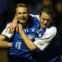 Arbroath v St Johnstone..  01.01.03<br />Tommy Lovenkrands celebrates giving St Johnstone the lead Ian Maxwell<br /><br />Pic by Graeme Hart<br />Copyright Perthshire Picture Agency<br />Tel: 01738 623350 / 07990 594431