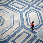 Bird's eye view of a woman passing by near Piazza Bologna in Rome, Italy.