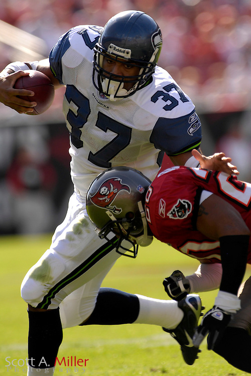 Dec. 31, 2006; Tampa, FL, USA; Seattle Seahawks running back (37) Shaun Alexander tries to avoid Tampa Bay Buccaneers defender (20) Ronde Barber during the Seahawks game at Raymond James Stadium. ...©2006 Scott A. Miller