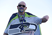 Feb 1, 2015; Glendale, AZ, USA; Seattle Seahawks fan Scott Smith poses for a photo before Super Bowl XLIX against the New England Patriots at University of Phoenix Stadium. The Patriots defeated the Seahawks 28-24.