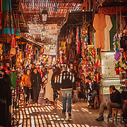 Exploring the souks of Marrakech. North of the gloriously mad Jemma al Fna the souk sprawls north. Traditionally all souks were divided and laid out according to separate commodities being made and sold, with the most valuable products (gold, manuscripts) positioned in the centre and lesser goods radiating out from there.